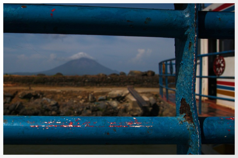 Ometepe - the volcano Concepcion through the rails of the ferry